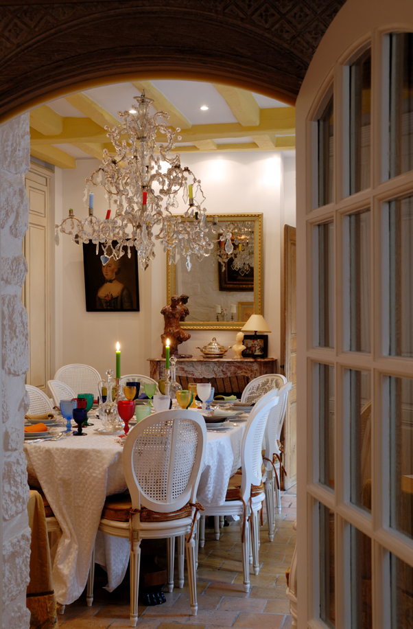Paris Villa 1032 - dining area has a real candle chandelier hanging under a traditional beamed ceiling
