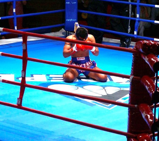 Thai Boxer doing Prayer before Fight