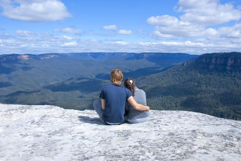 Romantic Couple enjoying the blue Mountain vista