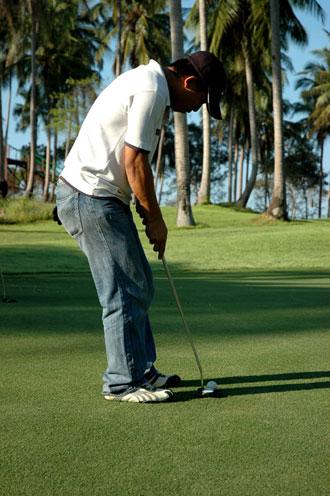 Golfer at Santiburi Golf Course