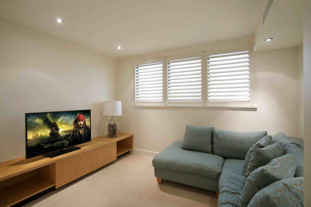 Queensland Villa 5302 - separate media room with a large flat screen television and comfortable couches for relaxing with full pay TV access for catching up on all those films and TV series
