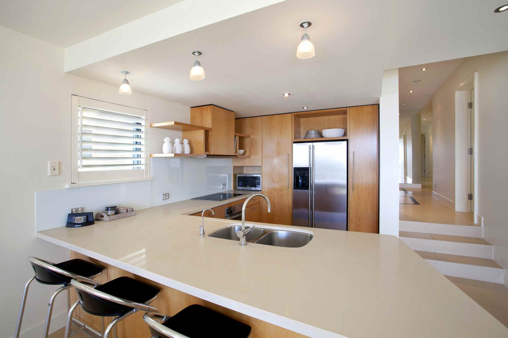 Queensland Villa 5302 - spacious kitchen features quality fittings and stone bench tops