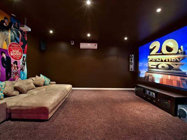 Queensland Villa 5310 - separate media room with a massive 60-inch flat screen television