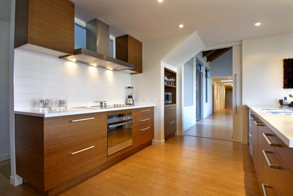 Queenstown Villa 637 - modern galley kitchen with warm timber cabinets