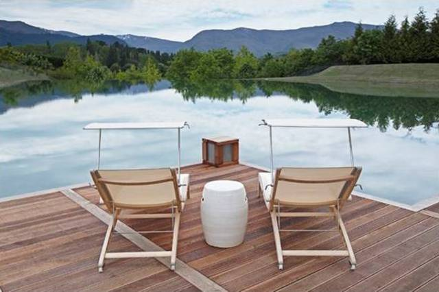 Queenstown Villa 663 -  The deck in turn, fronts a man-made lake with an infinity edge that provides endless reflections of the stunning scenery