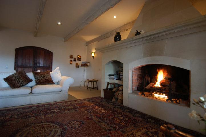 Wanaka Villa 631 - living area with a massive open fireplace
