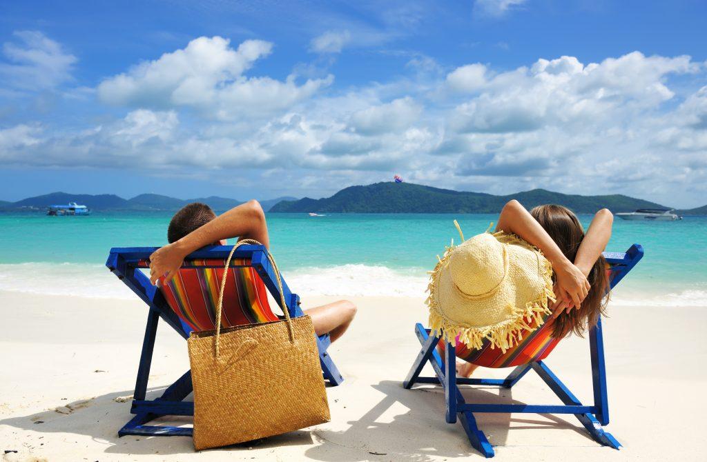 Couple on a tropical beach Villa Getaways Best Beach Front Villas
